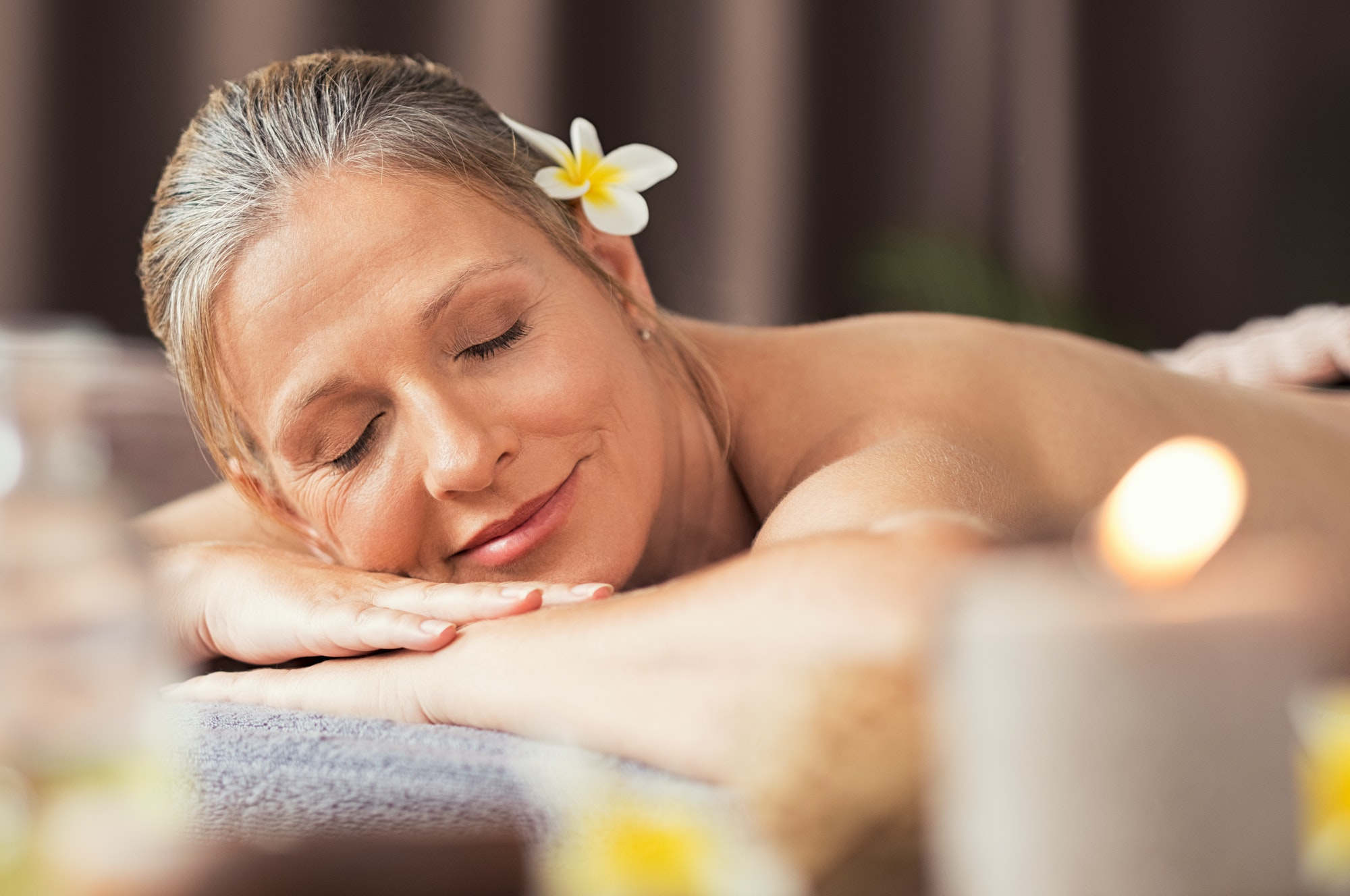 Senior woman relaxing at spa